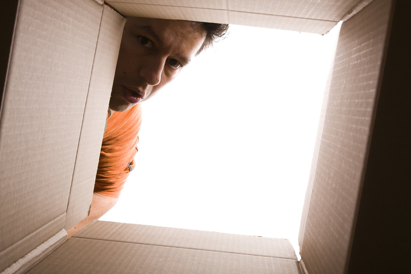 man looking through box