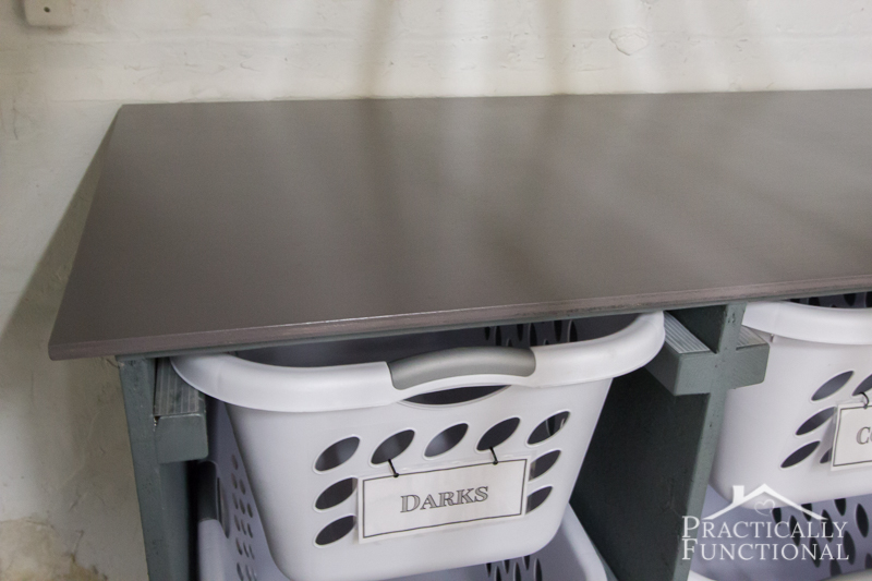 Simple-DIY-Laundry-Basket-Dresser-stained-and-sealed-top-piece-doubles-as-a-folding-and-sorting-station