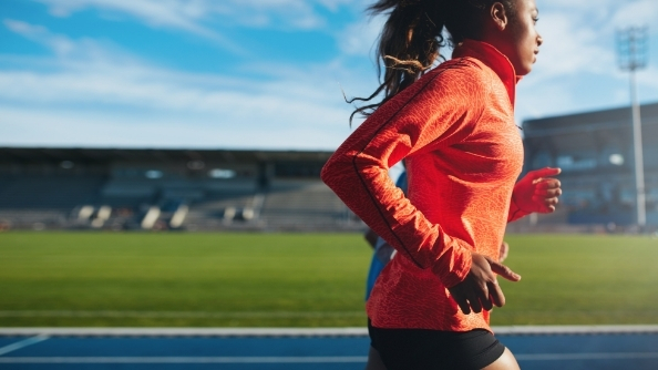 Athlete training while running on a track.