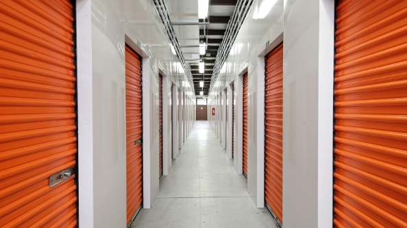Interior hallway with orange storage unit doors.