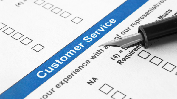 A customer service review document with pen.